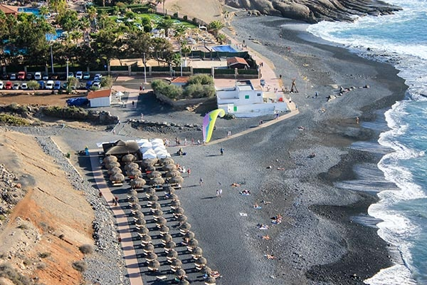 Aerial view C'queluche beach bar paragliding landing point of Sky of Tenerife