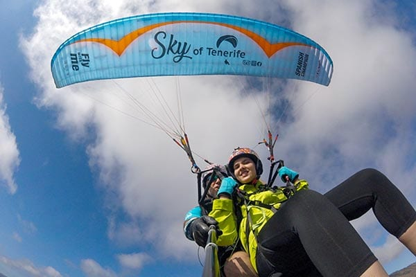 Paragliding tandem flight with sky of tenerife
